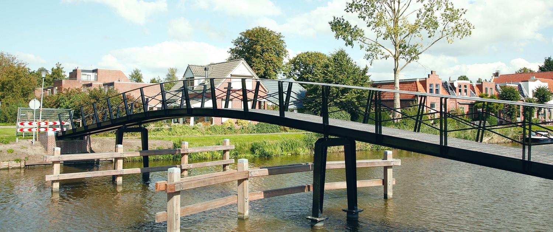 Appingedam fiets- en voetgangersbrug Damsterdiep flinke toog voor vereiste doorvaarthoogte brugontwerp