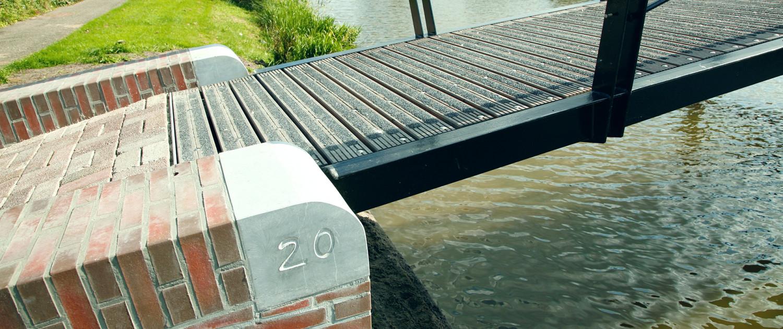 Hilgedagbrug Appingedam historische uitstraling brug met stalen constructie, houten dek, baksteen en natuursteen