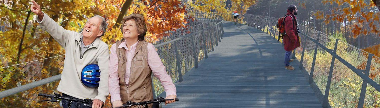 fiets en voegangersbrug tussen de boomtoppen, cirkelvormig fietspad op stalen kolommen, brugontwerp door ipv Delft