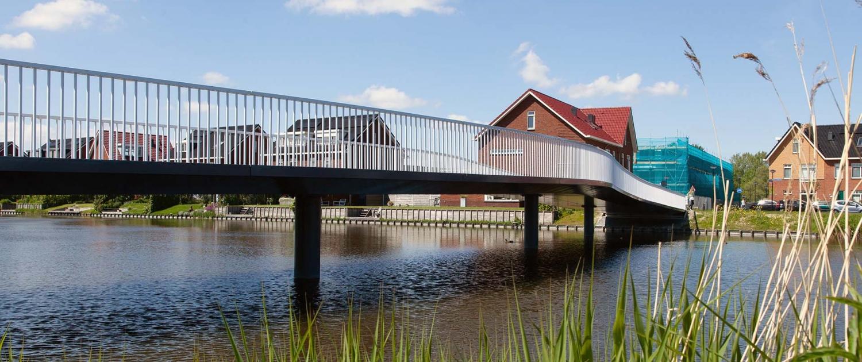 HHW.11_029_fietsbrug-De-Draa-Heerhugowaard-zij-aanzicht-vanaf-water-2-ipvDelft